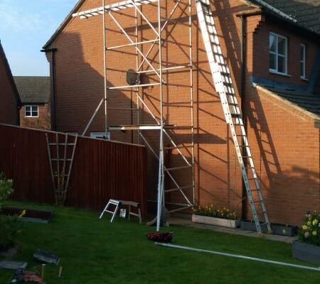 Day one - Scaffold tower in place - first panel on roof.